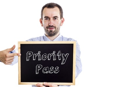 Priority Pass - Young businessman with blackboard - isolated on white - horizontal image Reklamní fotografie