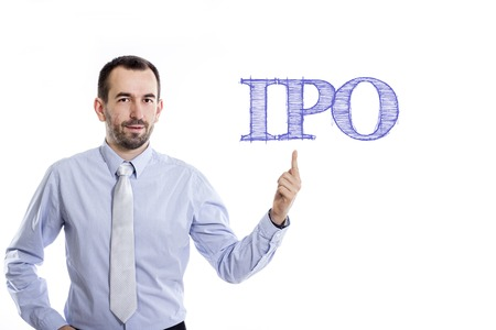 public offering: IPO - Young businessman with small beard pointing up in blue shirt - horizontal image