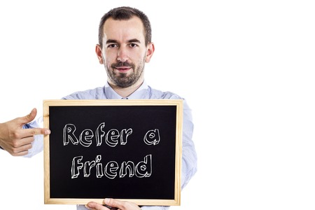 Refer a Friend - Young businessman with blackboard - isolated on white - horizontal image