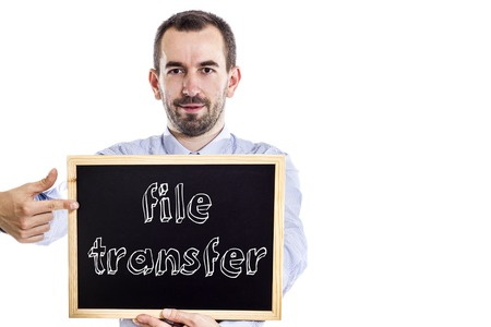 indexed: File transfer - Young businessman with blackboard - isolated on white - horizontal image Stock Photo