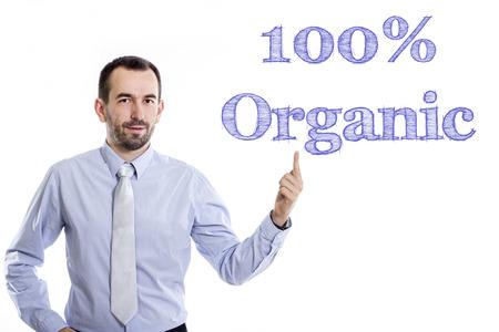 100 % 유기농 - 젊은 사업가 파란색 셔츠 - 가로 이미지를 가리키는 작은 수염을 가진 스톡 콘텐츠