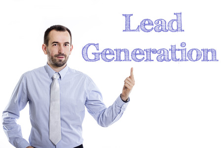 Lead Generation - Young businessman with small beard pointing up in blue shirt - horizontal image