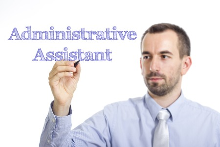 Administrative Assistant - Young businessman writing blue text on transparent surface - horizontal image