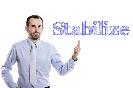 Stabilize - Young businessman with small beard pointing up in blue shirt - horizontal image