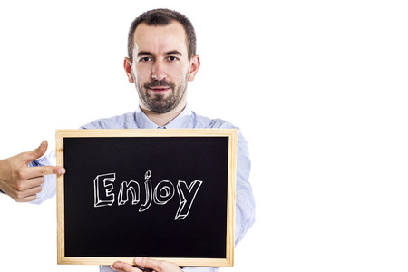 Enjoy - Young businessman with blackboard - isolated on white - horizontal image
