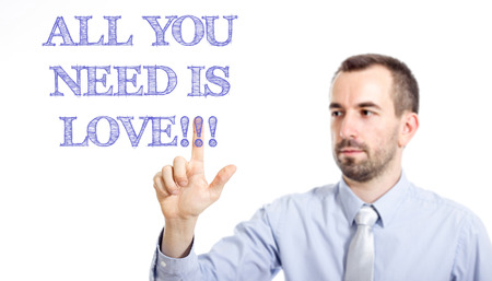All you need is love!!! Young businessman with small beard touching text - horizontal image