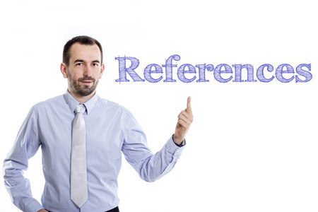 References - Young businessman with small beard pointing up in blue shirt - horizontal image