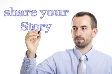 Share your story - Young businessman writing blue text on transparent surface - horizontal image