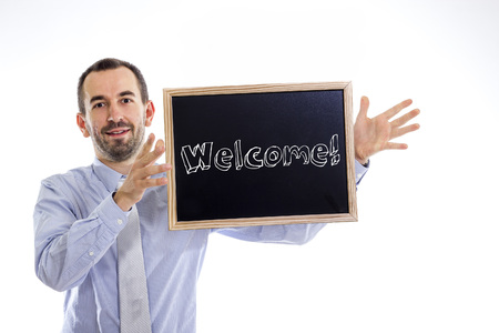 Welcome - Young businessman with blackboard - isolated on white - horizontal image Stok Fotoğraf