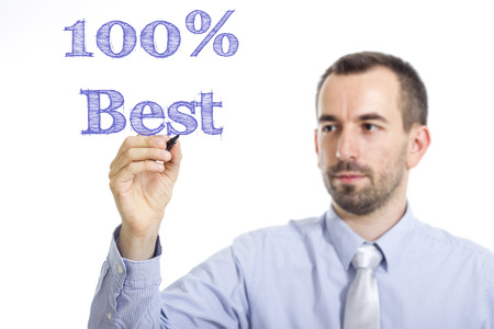 100% Best - Young businessman writing blue text on transparent surface - horizontal image Stok Fotoğraf