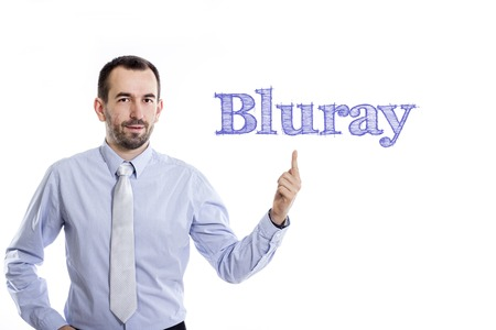 Bluray - Young businessman with small beard pointing up in blue shirt - horizontal image