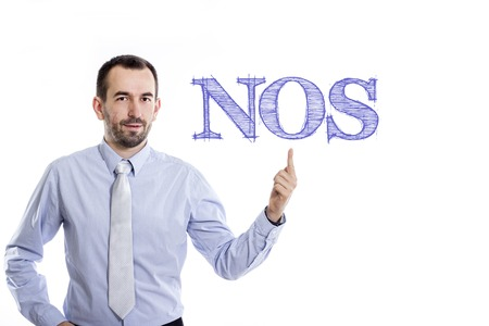 NOS - Young businessman with small beard pointing up in blue shirt - horizontal image