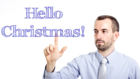 Hello Christmas Young businessman with small beard touching text - horizontal image