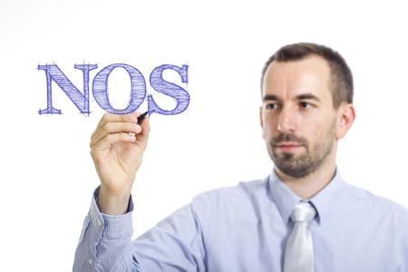 NOS - Young businessman writing blue text on transparent surface - horizontal image Stock Photo