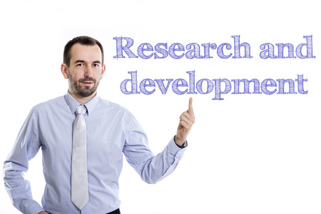 Research and development - Young businessman with small beard pointing up in blue shirt - horizontal image