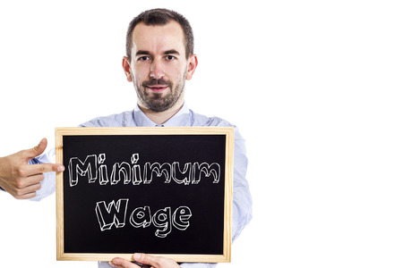 Minimum Wage - Young businessman with blackboard - isolated on white - horizontal image Banco de Imagens