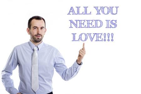 Tout ce dont tu as besoin c'est de l'amour !!! Jeune homme d'affaires avec une petite barbe pointant vers le haut en chemise bleue - image horizontale Banque d'images - 73123022