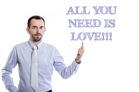 All you need is love!!!  Young businessman with small beard pointing up in blue shirt - horizontal image