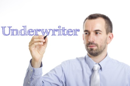 underwriter: Underwriter - Young businessman writing blue text on transparent surface - horizontal image Stock Photo