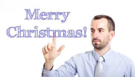 Joyeux Noël! Jeune homme d'affaires avec la petite barbe touchant le texte - image horizontale Banque d'images - 73195145