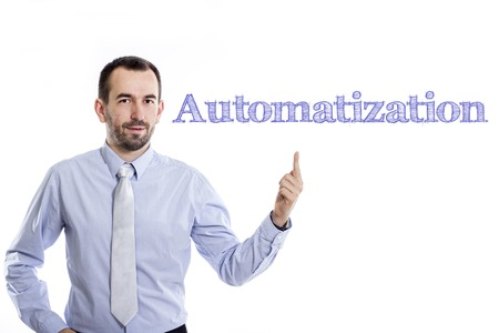 Automatization - Young businessman with small beard pointing up in blue shirt - horizontal image Stock Photo