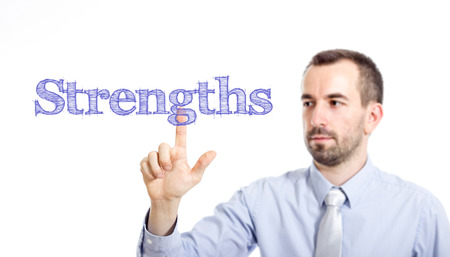Strengths Young businessman with small beard touching text - horizontal image