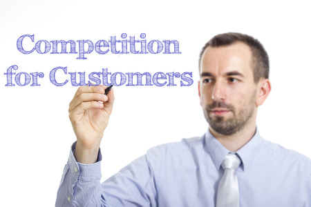 Competition for Customers - Young businessman writing blue text on transparent surface - horizontal image