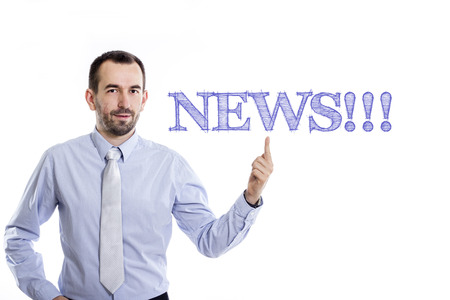 NEWS!!! - Young businessman with small beard pointing up in blue shirt - horizontal image