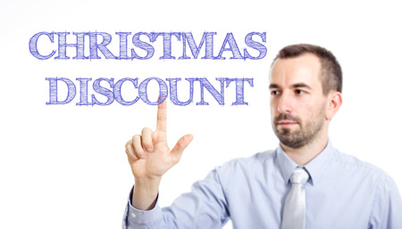 Christmas Discount Young businessman with small beard touching text - horizontal image