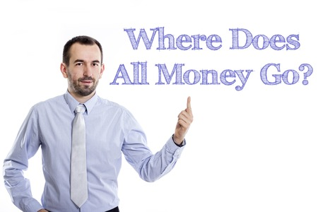 where to go: Where Does All Money Go? - Young businessman with small beard pointing up in blue shirt - horizontal image Stock Photo