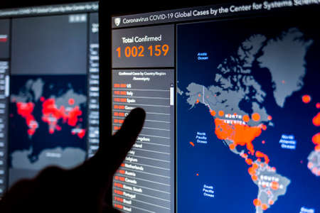 Over 1 million. Number of Total Confirmed Cases. Expert point Coronavirus COVID-19 global cases Map Johns Hopkins University map on monitor display. 報道画像