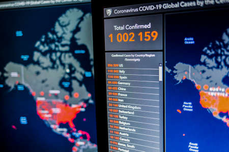Over 1 million. Number of Total Confirmed Cases. Coronavirus COVID-19 global cases Map Johns Hopkins University map on monitor display.