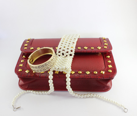 Red purse and Pearl necklace photo