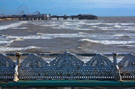 Cast iron park benches on a windy seashore Stock Photo