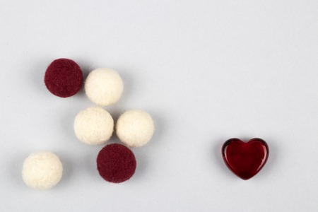 Set of woolen balls and heart as a symbol of warm home full of love