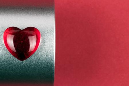 Stylish red heart on metallic box as a Valentine gift on red background 版權商用圖片