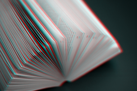 Education and reading concept. Sheets of book full of mysteries, stories and plots - image with glitch effect Stock fotó