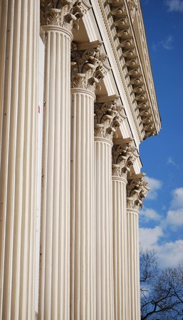 buildup: White rock columns detail with blue sky.