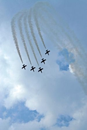 aerobatic: Aerobatic team making loopings in the air Stock Photo