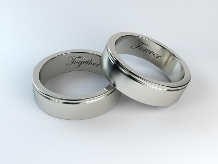 hacer de los anillos de bodas con el grabado Foto de archivo