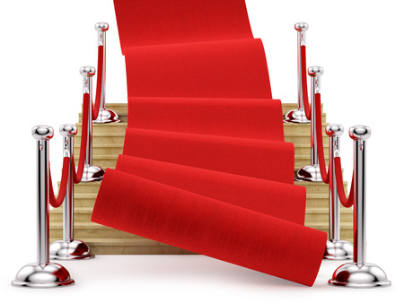 red carpet rolling down the stairs, isolated on white  photo