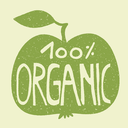 Hand lettering of the text 100% organic on a green apple. Stamp effect. Illustration
