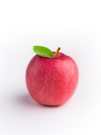 A red apple with leaves