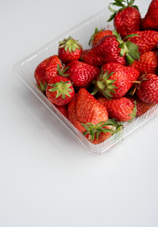 A box of fresh strawberries Фото со стока