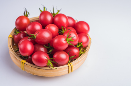 Many Cherry tomatoes packed in bamboo basket