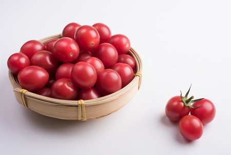 Many Cherry tomatoes packed in bamboo basket Banco de Imagens - 111009600