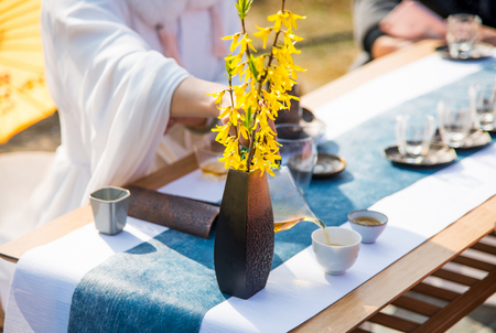 A young woman's tea ceremony. The bubbling tea was poured out of the teapot mouth.