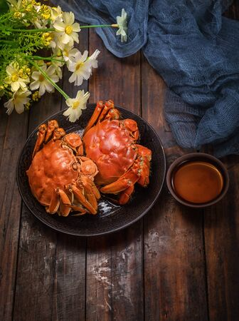 Two cooked hairy crabs on the plate.