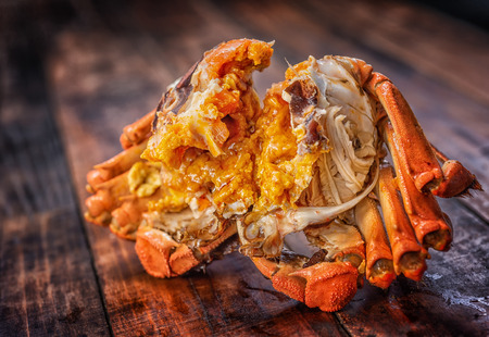 The hairy crab stripped its shell and poster its rich crab cream.