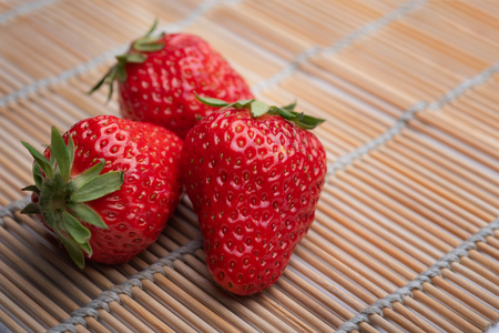 Strawberries on bamboo mats